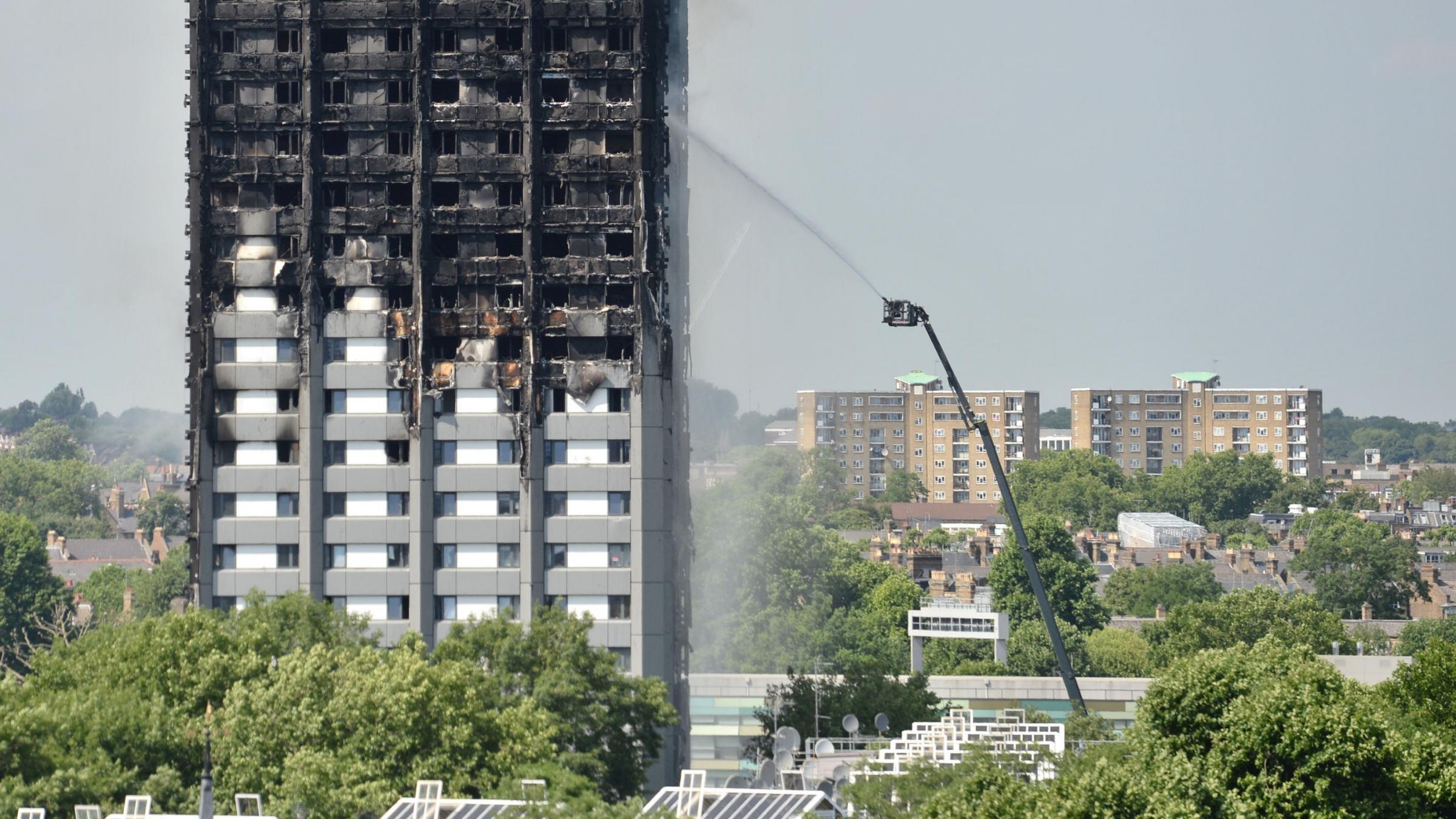 Britain's May Meets with Victims of Deadly High-rise Blaze
